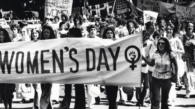black and white image of women marching