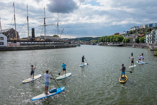 students paddle boarding in Bristol