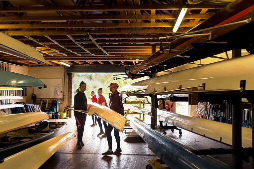 students in a boathouse in durham