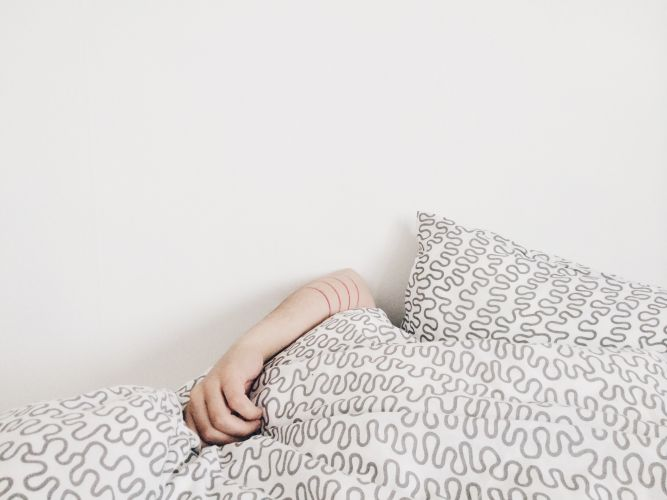 A person under the duvet