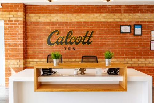 logo of calcott ten which is inspired by the history of the building