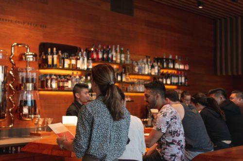 people sat drinking in a pub in london