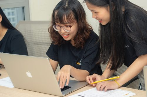 Two girls with laptop looking at a level results